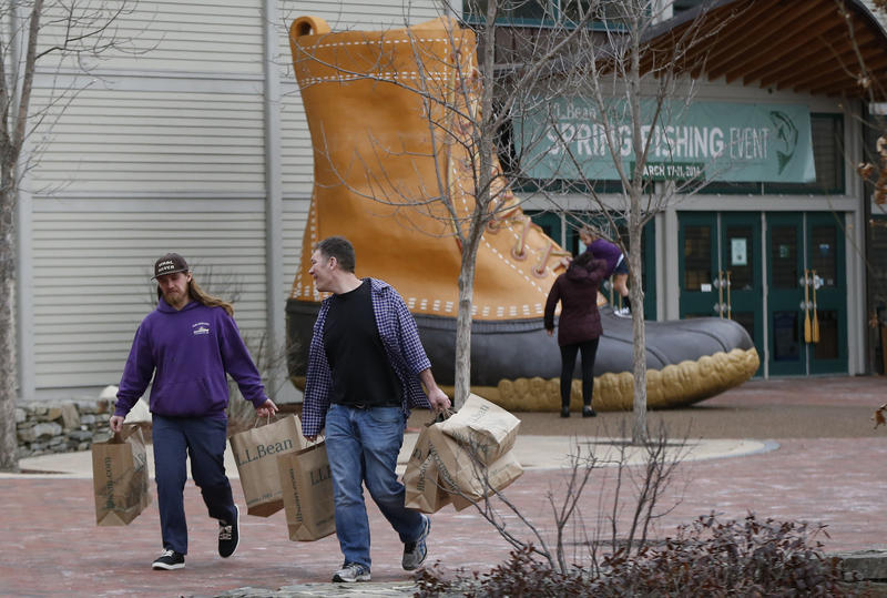 In this Wednesday, March 16, 2016 photo shoppers leave the L.L. Bean retail store in Freeport, Maine.