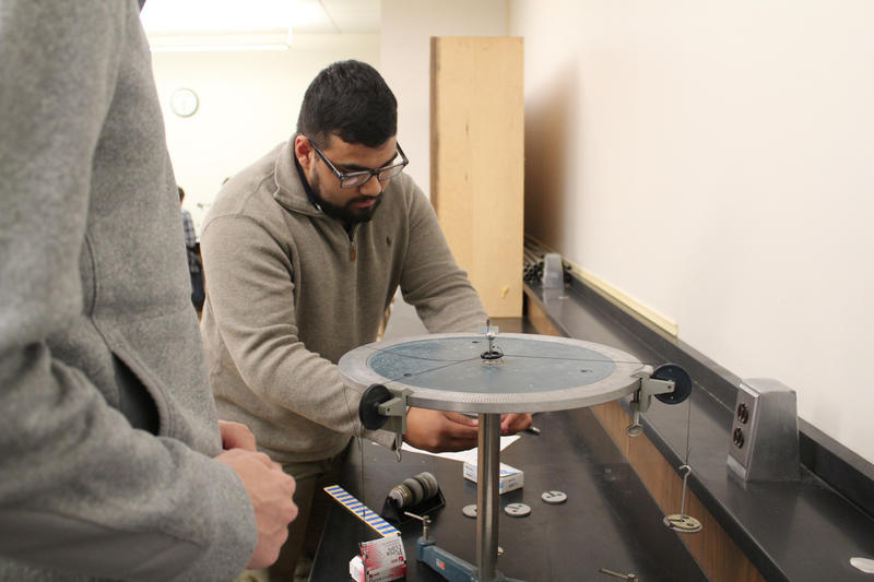 First-year student Phil Parent works with force tables in an introductory physics class at the University of Maine at Machias.