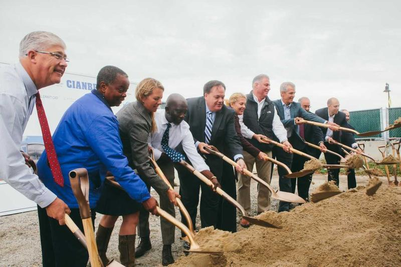 Members of the Portland City Council, WEX leadership and the project's developer break ground Tuesday for the company's new headquarters on the Portland waterfront.