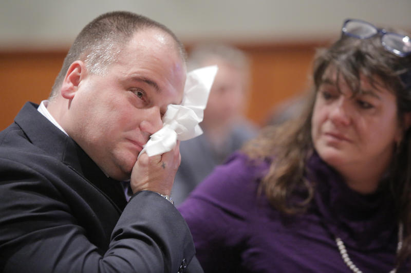 Anthony Sanborn wipes his eyes as the details of an agreement with the state are announced at the Cumberland County Courthouse in Portland on Wednesday, Nov. 8, 2017.