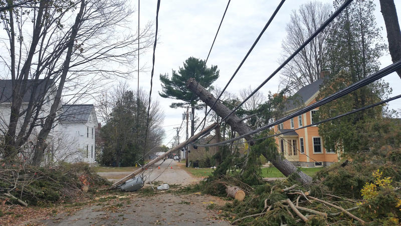 A broken pole and downed wires lie across a street in Yarmouth Wednesday.