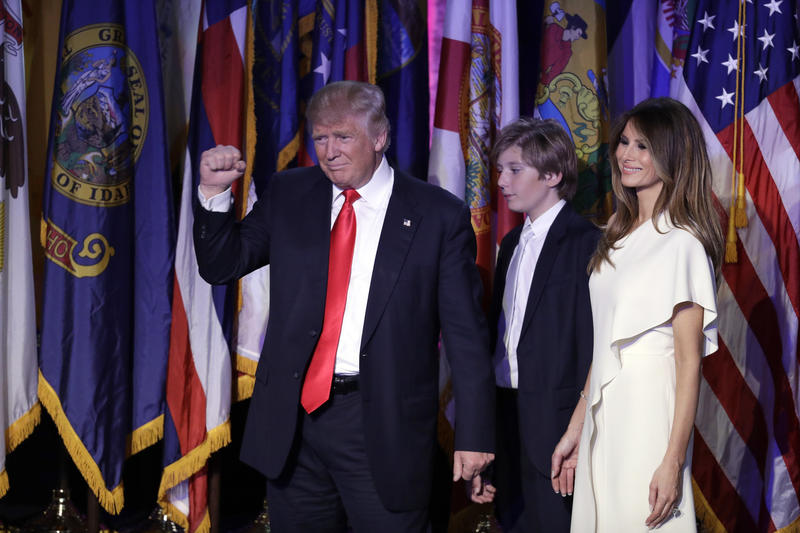President-elect Donald Trump pumps his fist after giving his acceptance speech as his wife Melania Trump, right, and their son Barron Trump follow him during his election night rally, Wednesday, Nov. 9, 2016, in New York. (AP Photo/John Locher)