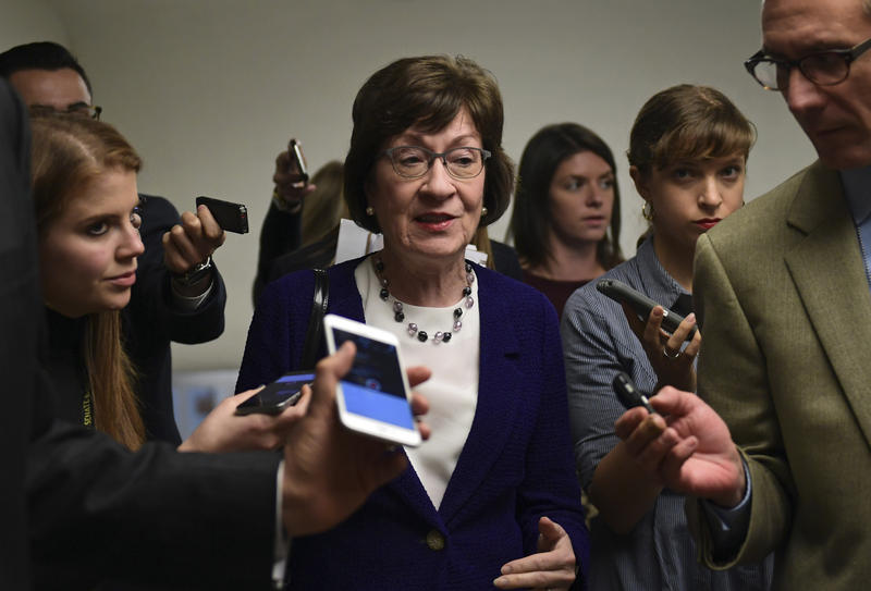 Sen. Susan Collins, R-Maine, is surrounded by reporters as she heads to go vote on Capitol Hill in Washington, Tuesday, Nov. 7, 2017.