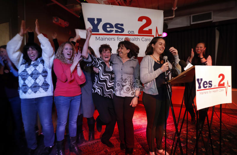 Supporters of Medicaid expansion celebrate their victory, Tuesday, Nov. 7, 2017, in Portland.