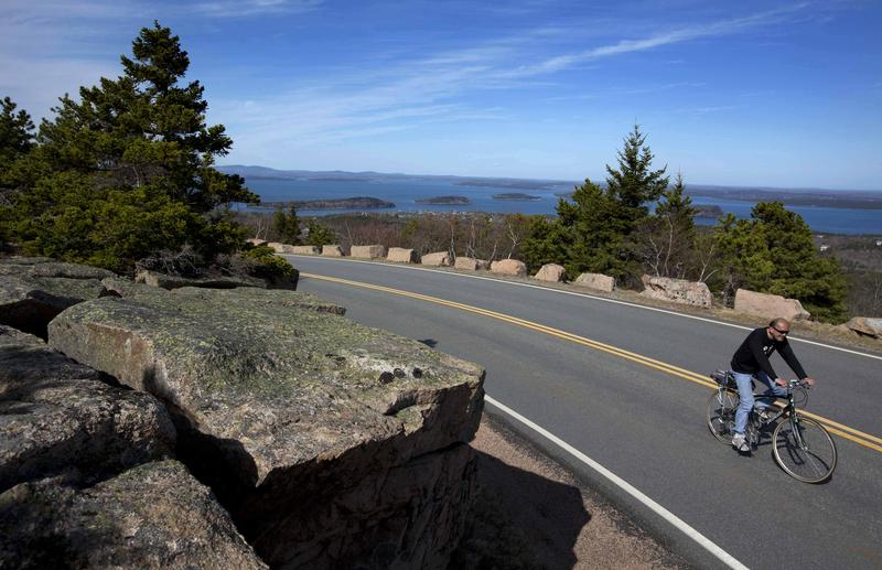 A bicyclist pedals up the road to the summit of Cadillac Mountain in May 2013.