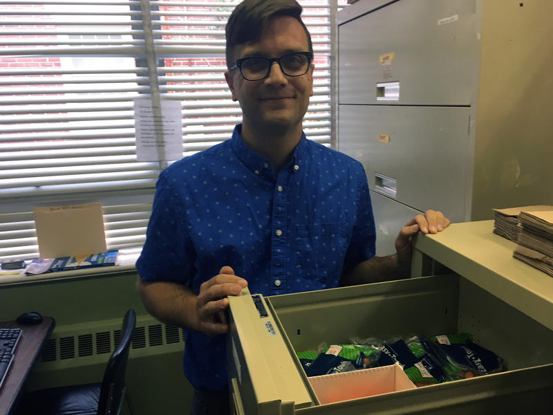 Kenney Miller, executive director of the Health Equity Alliance, shows a drawer of supplies at the needle exchange in Bangor.