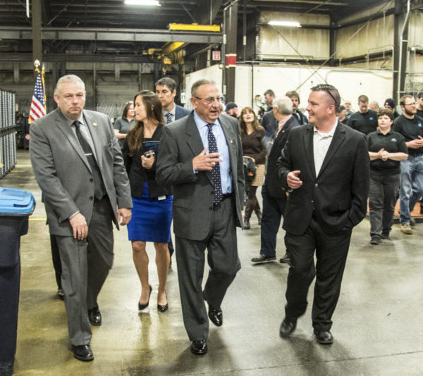 Gov. Paul LePage walks with Mike Seile, vice-president of the auto parts manufacturer Somic America, during a tour of the Brewer company's factory floor, May 5, 2017.