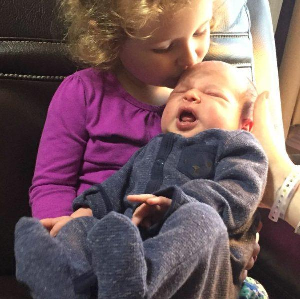 Newborn Colton Scott Geel is greeted by his two-year-old sister, Cora, shortly after being born at Eastern Maine Medical Center in Bangor on Oct 28.