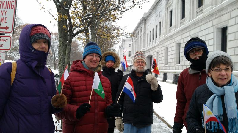Rob Levin (second from left) is joined by a group of supporters as they walk around the federal courthouse in Portland 195 times, once for each country that has signed onto the Paris climate agreement.