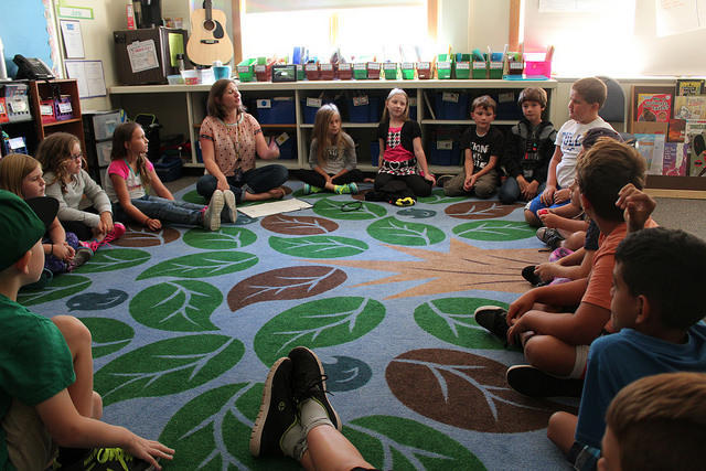 "Third-grade teacher Sara Wilder leads her class in a ""community circle"" at Loranger Memorial School in Old Orchard Beach in 2016."