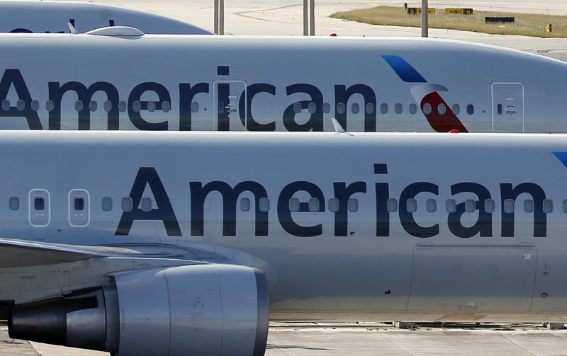 In this Monday, Nov. 6, 2017, file photo, a pair of American Airlines jets are parked on the airport apron at Miami International Airport in Miami.
