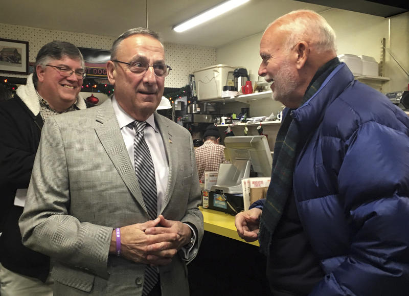 Maine Gov. Paul LePage (left) talks with a customer at Simone's Hot Dog Stand in Lewiston while campaigning for a local candidate on Thursday, Dec. 7, 2017.