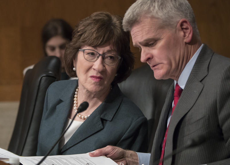 Sen. Susan Collins, R-Maine, confers with Sen. Bill Cassidy, R-La., during a Senate committee hearing on Capitol Hill in Washington, Tuesday, Dec. 12, 2017.
