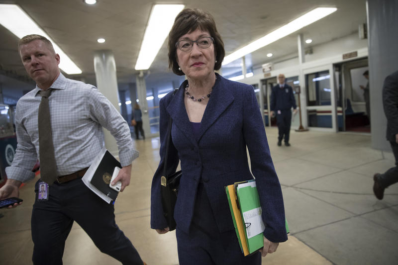 Sen. Susan Collins, R-Maine, arrives for a caucus meeting as the Republican majority in Congress prepares to vote on the biggest reshaping of the U.S. tax code in three decades, on Capitol Hill, in Washington, Tuesday, Dec. 19, 2017.