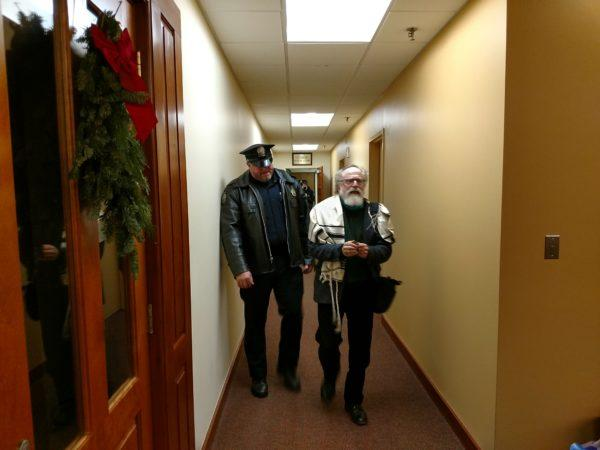 Police arrested Rabbi Joshua Chason, 71, of Portland, for criminal trespassing around 8 p.m. Thursday, after he and a group of other faith leader spent about 10 hours occupying U.S. Sen. Susan Collins' office in protest of the GOP tax plan.