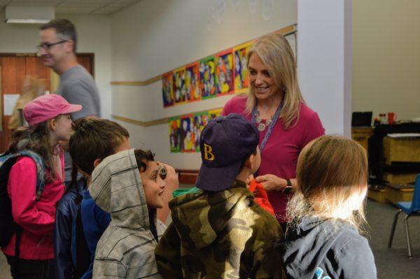 Miles Lane School Principal Christina Ellis talks with second graders, including Jaden Atherton, 7, of Bucksport, in profile, before they leave for a field trip to Acadia National Park on Oc. 27, 2017.