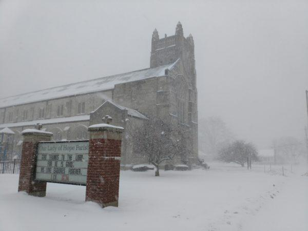 A church in a cloud of snow on Christmas Day.