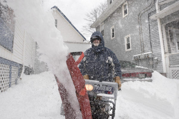 Eighty-year-old Ed Cyr used a snowblower to clear his driveway at his Bangor home in this photo from March 2017.