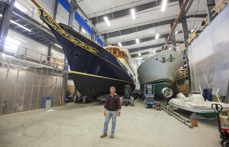 JB Turner of Front Street Shipyard in Belfast, along with two yachts undergoing overhauls.