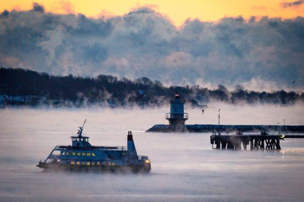 The Peaks Island ferry heads out on early on Jan. 2, 2018 across Portland Harbor as sea smoke rises around it. Sea smoke is formed when very cold air moves over warmer water.