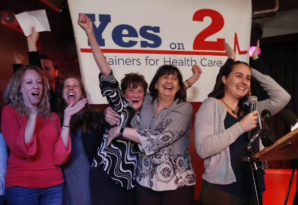 In this Tuesday, Nov. 7, 2017, file photo, supporters of Medicaid expansion celebrate their victory, in Portland, Maine.