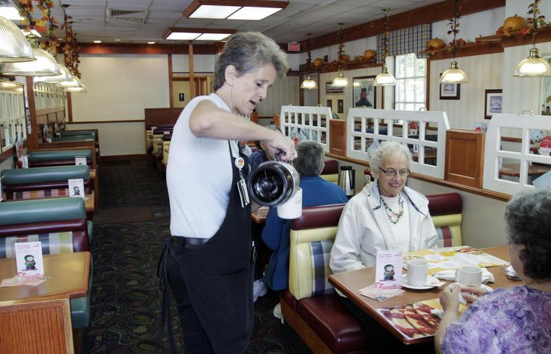 A waitress pours coffee for patrons at Friendly's restaurant in Brunswick, Maine on Wednesday, Oct. 5, 2011.