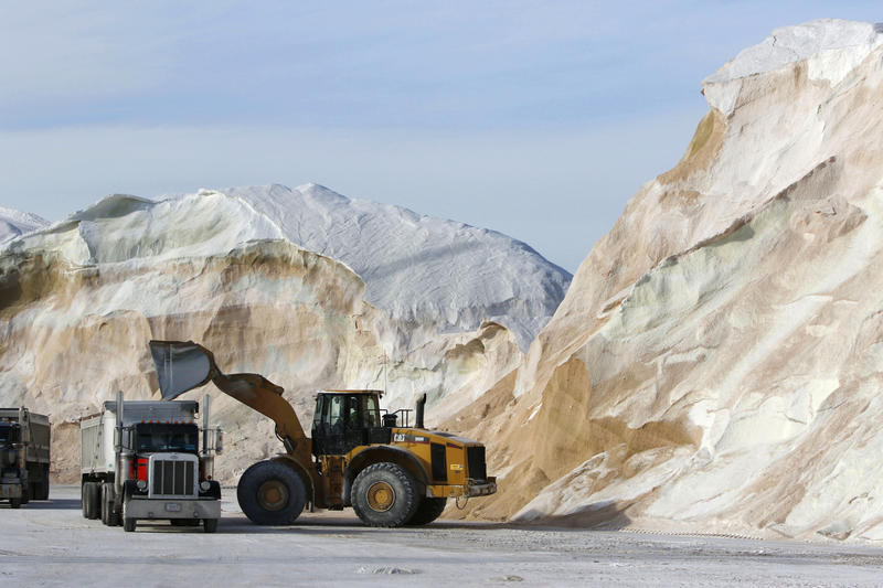 In this Jan. 3, 2018 file photo, road salt is loaded into trucks at Eastern Minerals Inc., in the Boston suburb of Chelsea, Mass.