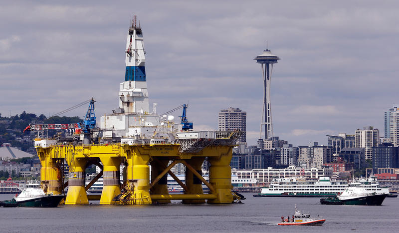 The oil drilling rig Polar Pioneer is towed toward a dock Thursday, May 14, 2015, in Elliott Bay in Seattle.