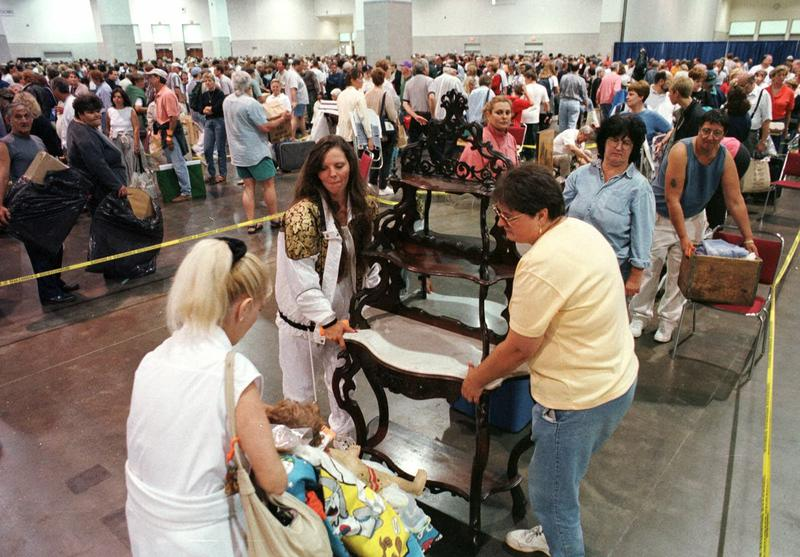 Thousands of people wait in line to have their treasured possessions appraised by a team of experts during the final stop of the popular PBS television program, Chubb's Antiques Roadshow, Saturday, Aug. 21, 1999, in Providence, Rhode Island.