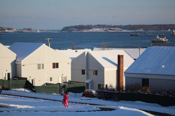 A young girl walks through the Munjoy South Townhouse Apartments property on Portland's desirable Munjoy Hill, overlooking Portland Harbor, Thursday, Jan. 18, 2018.