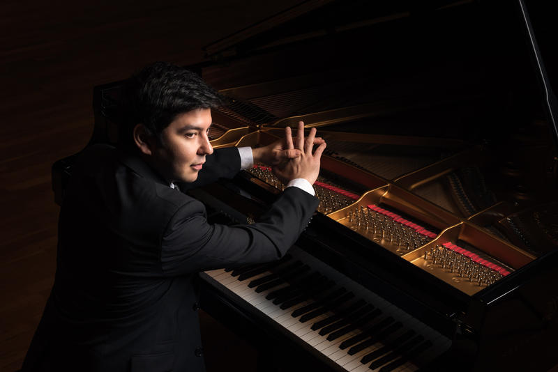 Behzod Abduraimov sitting at the piano