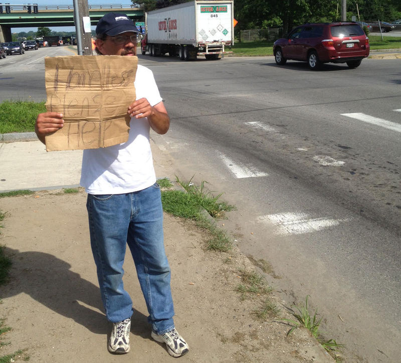 A Panhandler on the side of a street in Portland