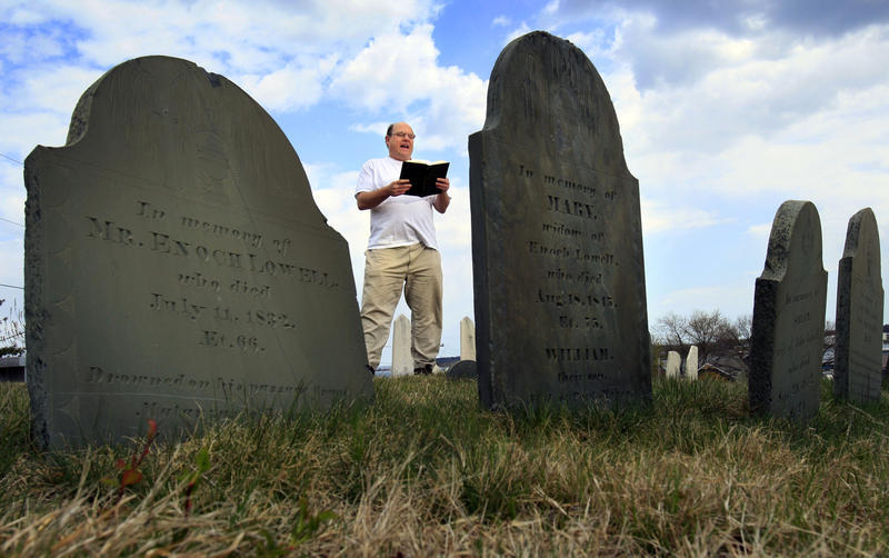 In this April 20, 2010 file photo, Walter Skold of Freeport, Maine, reads a Henry Wadsworth Longfellow poem while posing in Eastern Cemetery in Portland, Maine.