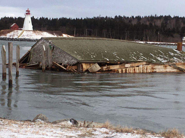 Pictured in this photo from Friday, Jan. 5 are the remains of the herring brining shed of McCurdy's Smokehouse, sitting in Lubec Narrows.