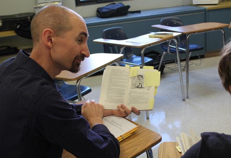 Interventionist Derek Cote works with a student on catching up in English at Oak Hill High School. Administrators hope that with Cote's work and other interventions, fewer students will fall behind.