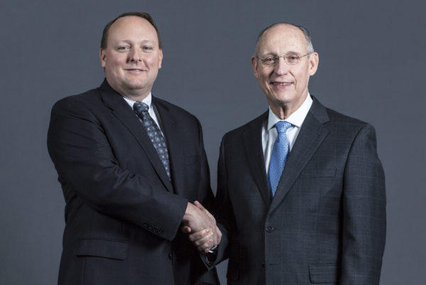 "Peter ""Andi"" Vigue (left) in January took over as CEO as The Cianbro Companies from his father Peter Vigue, who has been at Cianbro for 48 years, 17 of them as CEO."
