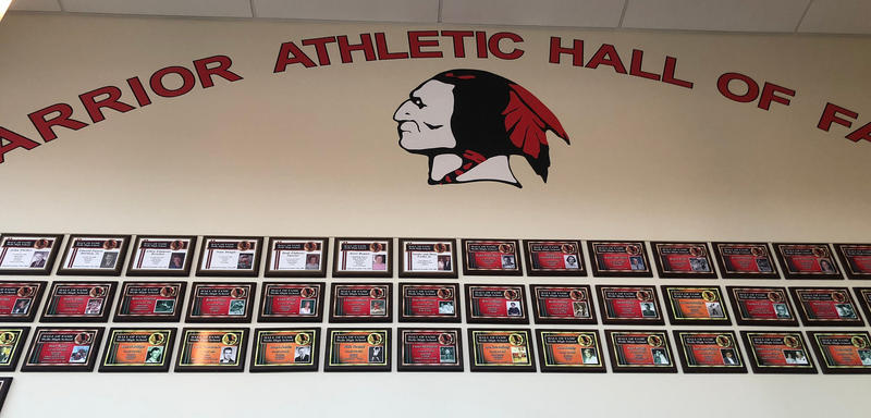 The Warriors mascot, painted on a wall at Wells High School's athletic center.