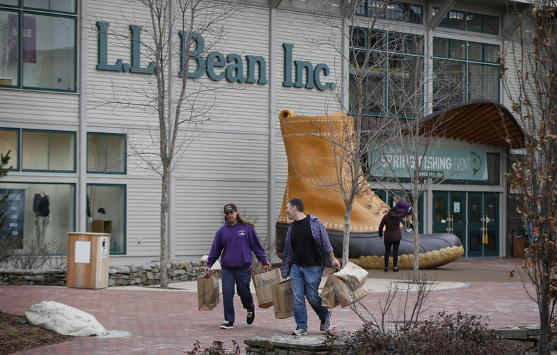 In this Wednesday, March 16, 2016 photo shoppers walk outside the L.L. Bean retail store in Freeport, Maine.