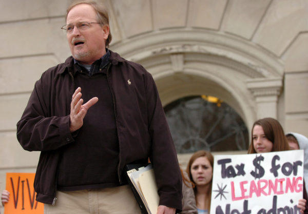 In this April 2010 file photo, theater professor Tom Mikotowicz speaks on the steps of Fogler Library on campus in Orono during a rally regarding proposed reductions of academic programs at the unversity