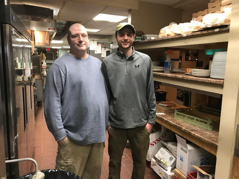 Former Downeast Correctional Facility prisoner Raphael Bradley, left, with his manager, Nate Burke, at Pat's Pizza in Machias.