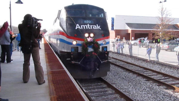 File photo from 2012 of the first trip of Amtrak Downeaster's passenger train service from Boston to Freeport and Brunswick. Hundreds of people greeted the train.