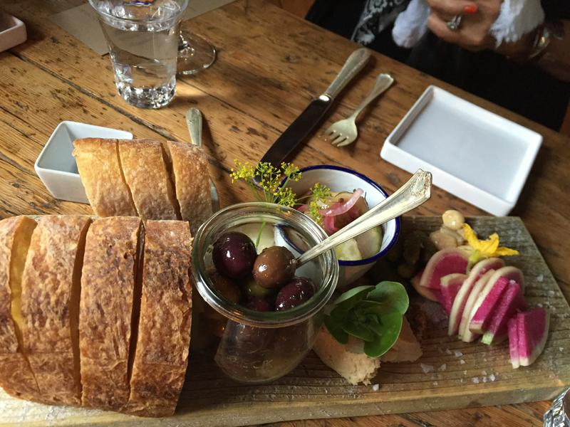 Bread, olives and other pre-dinner nibbles served at The Lost Kitchen in Freedom, Maine, before the meal begins in Aug. 2016.