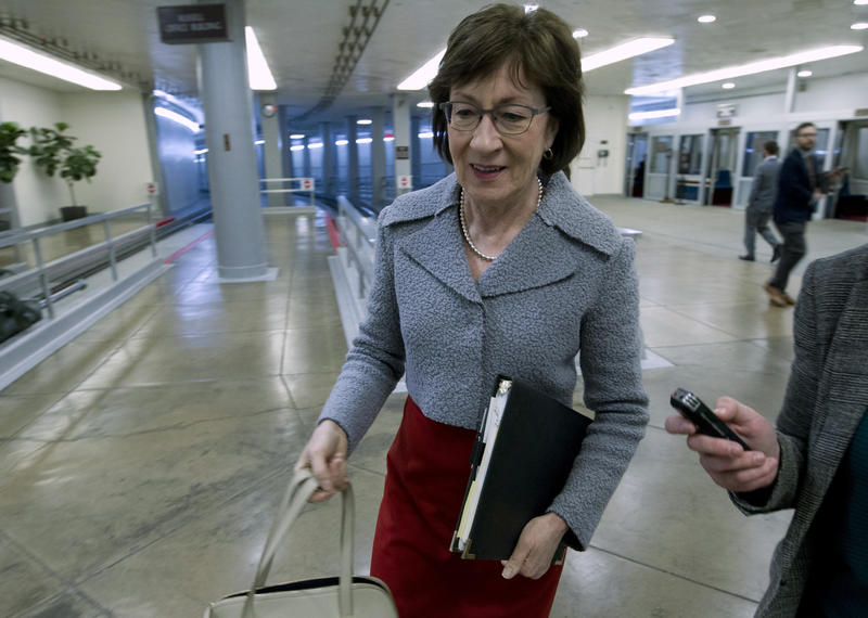 Sen. Susan Collins, R-Maine, walks to the senate floor, Thursday, Feb. 8, 2018, at Capitol Hill in Washington.