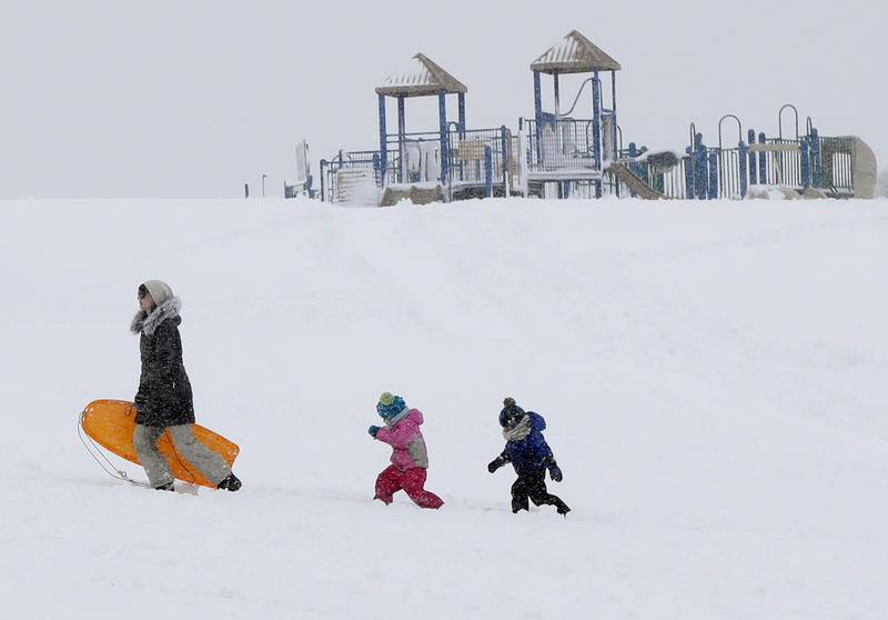 Christina Mesavage leads family friend Una Mayer (center) and her son Jude up a sledding hill at the Eastern Promenade while enjoying the snow during a nor'easter Thursday, March 8, 2018, in Portland.