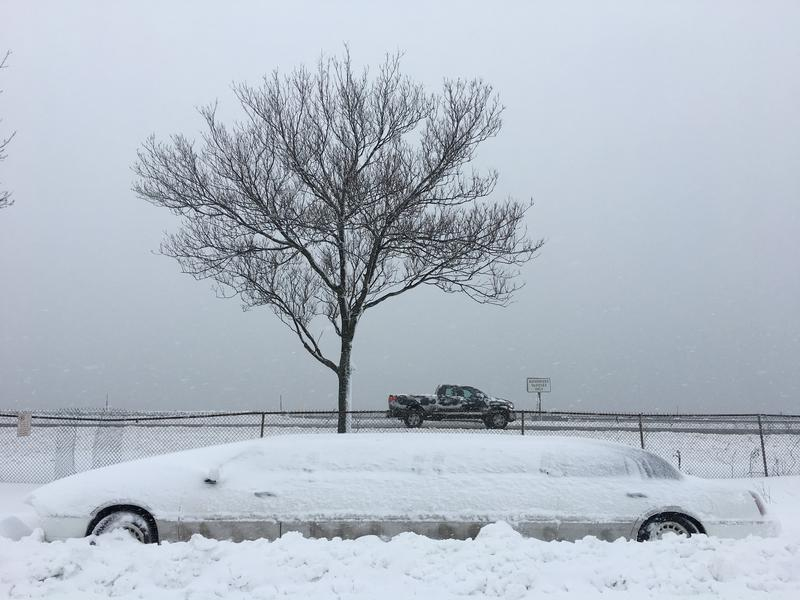 A snow-covered limo on Marginal Way in Portland on Thursday.