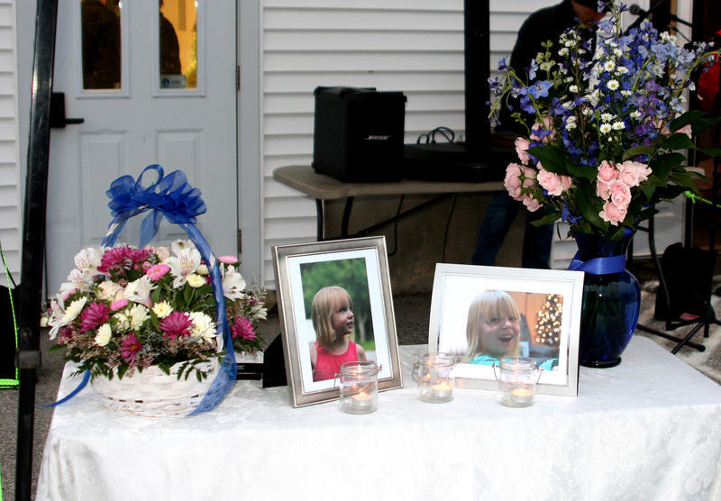 Photos of 10-year-old Marissa Kennedy are displayed on a table at a vigil in Stockton Springs March 4, 2018..