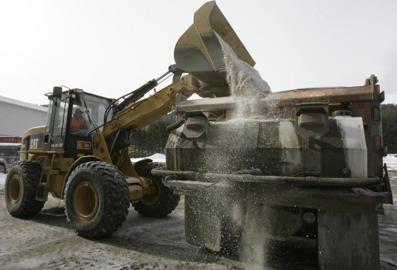 An Agency of Transportation worker loads salt in a plow truck in Vermont