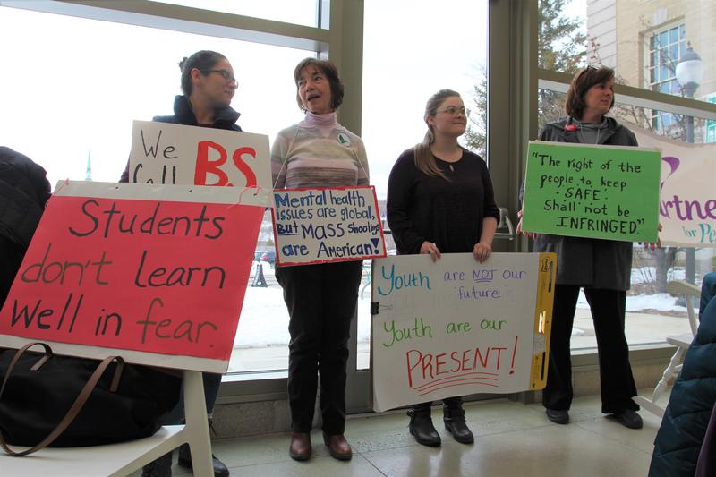 Students and parents at a press conference at the Bangor Public Library on Monday.