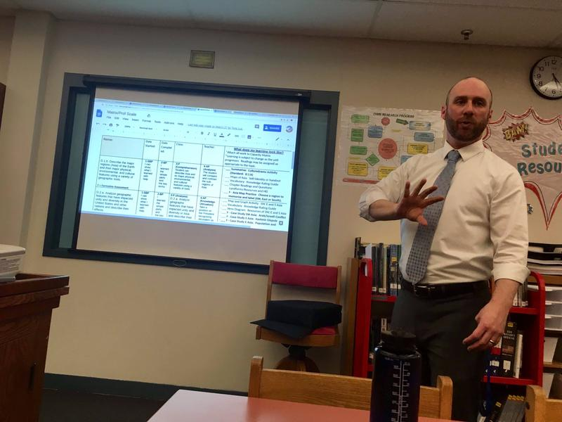Oak Hill High School Principal Marco Aliberti giving a presentation on the district's grading system to concerned parents in the school's library