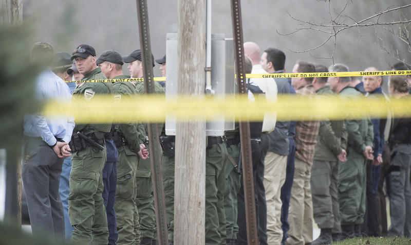 Law Enforcement personnel line the street as the body of Somerset County Sherrif Deputy Eugene Cole is brought out and loaded into a medical examiners van